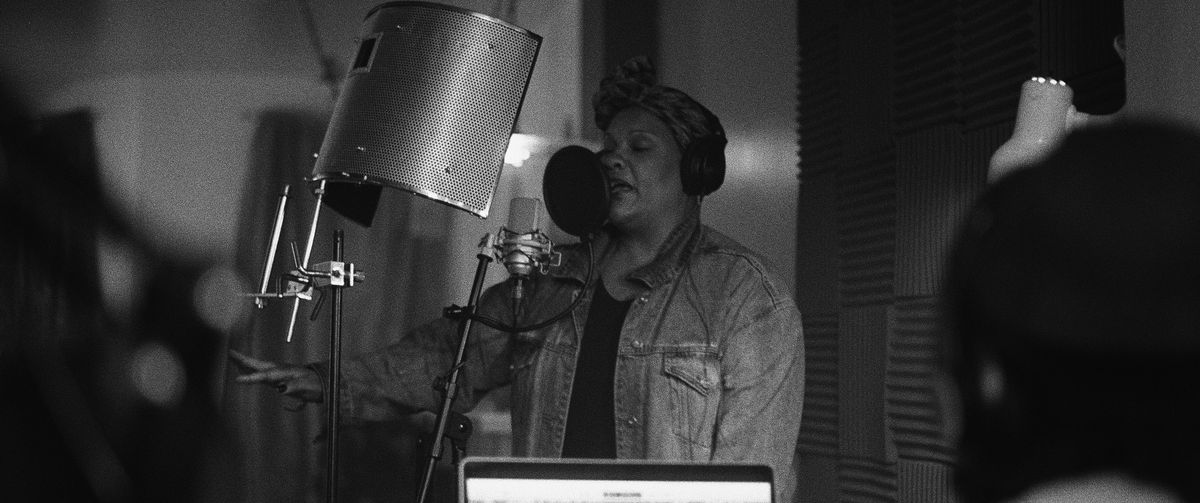 Radha Blank spits verses at the mic in an apartment production studio in The Forty-Year-Old Version
