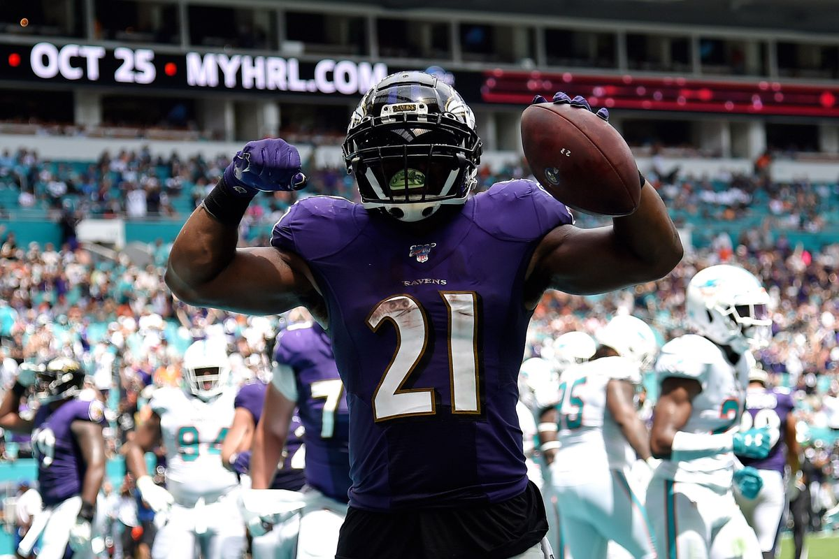 Baltimore Ravens running back Mark Ingram celebrates his touchdown run against the Miami Dolphins during the first half at Hard Rock Stadium.
