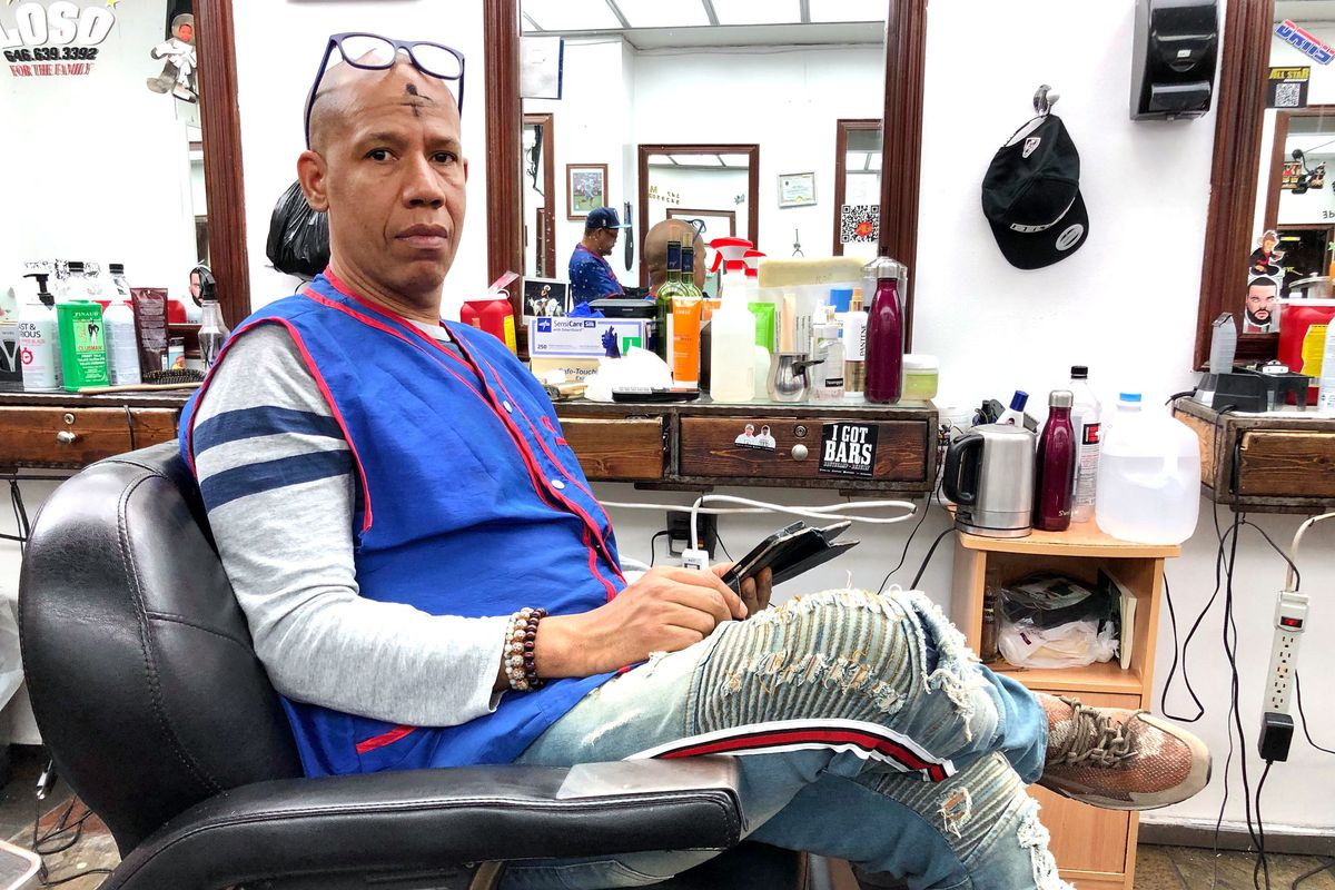 Washington Heights barber, Domingo Santos, said many of his customers won't vote because they believe Trump will win again.