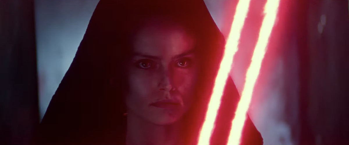 Rey, with two Sith lightsaber blades.