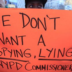 Todd Jaime, of Brooklyn, holds a sign expressing his views during a rally asking for the resignation of NYPD Commissioner Ray Kelly and NYPD spokesperson Paul Browne, in a demand for independent community control of the NYPD, and a well-funded oversight mechanism with subpoena power, Friday, Feb. 3, 2012 in New York.  Thirty-three civil rights groups from around America complained to the New York attorney general Friday about police documents that showed the New York Police Department recommending increased surveillance of Shiite mosques based solely on their religion. The letter urged Attorney General Eric Schneiderman to investigate NYPD's surveillance operations, which monitored entire neighborhoods and built databases about everyday life in Muslim communities.