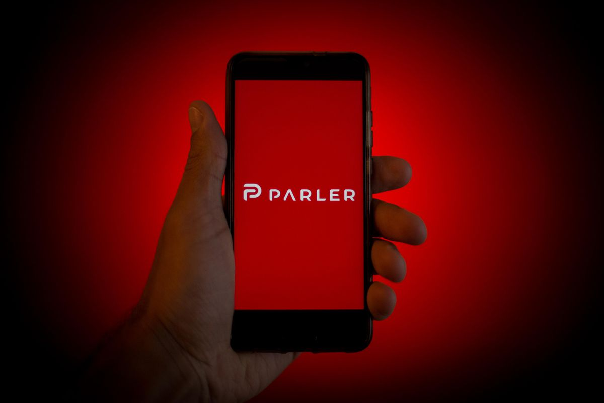 In this photo illustration a Parler logo is seen displayed...
