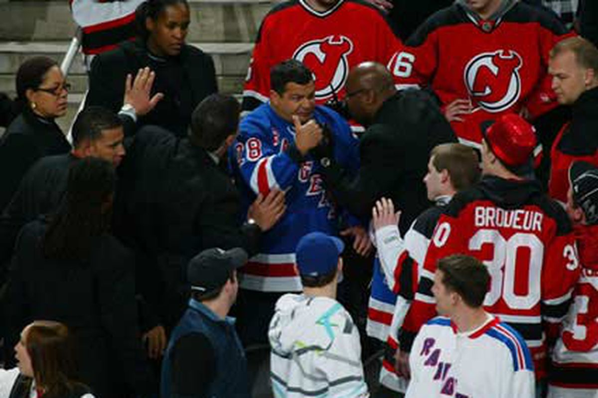 This Ranger fan got attacked by all four Devils fans at the last Rangers-Devils game at The Rock in Newark.