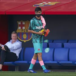 Pedri watches from the bench