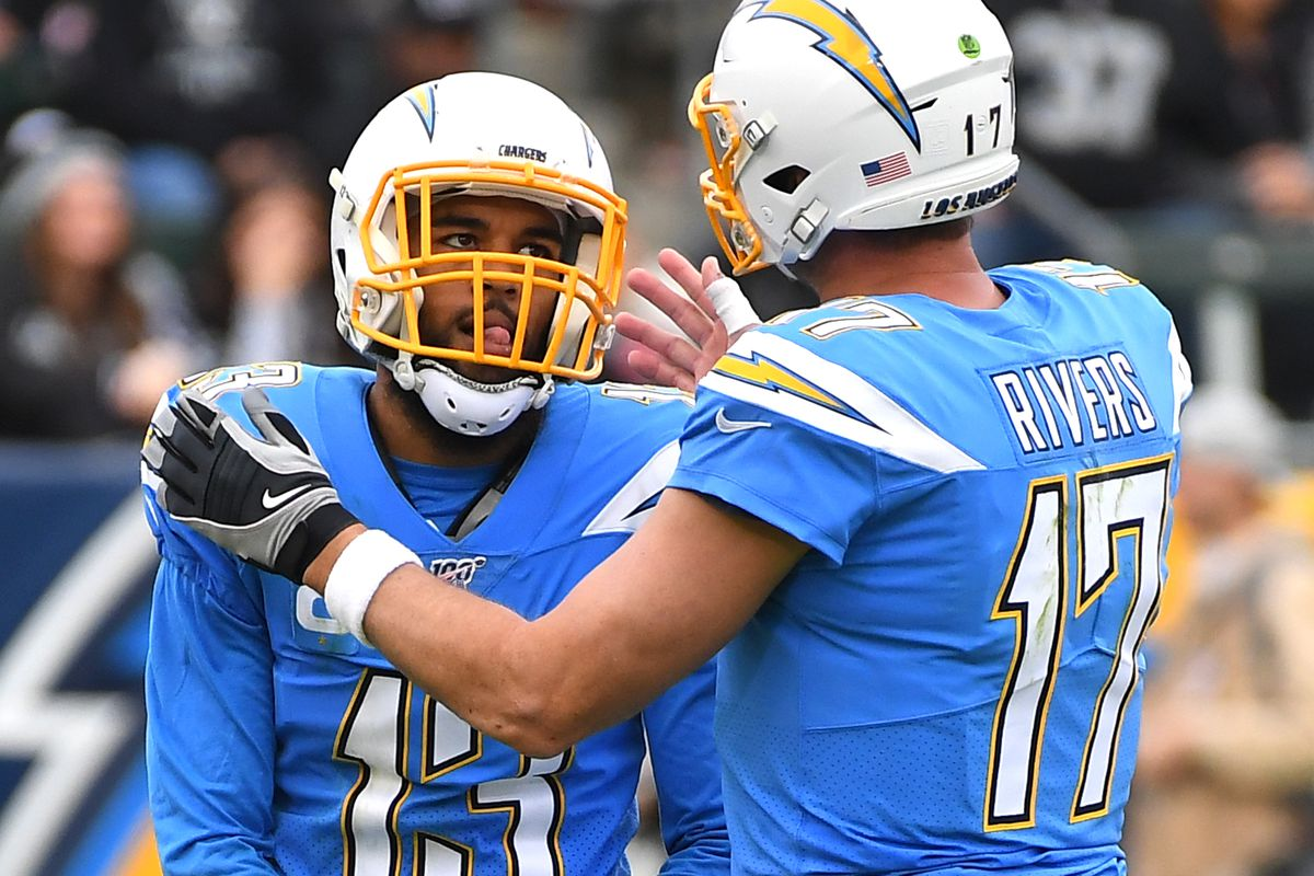 Quarterback Philip Rivers talks with wide receiver Keenan Allen of the Los Angeles Chargers after an incomplete pass in the second half of the game against the Oakland Raiders at Dignity Health Sports Park on December 22, 2019 in Carson, California.