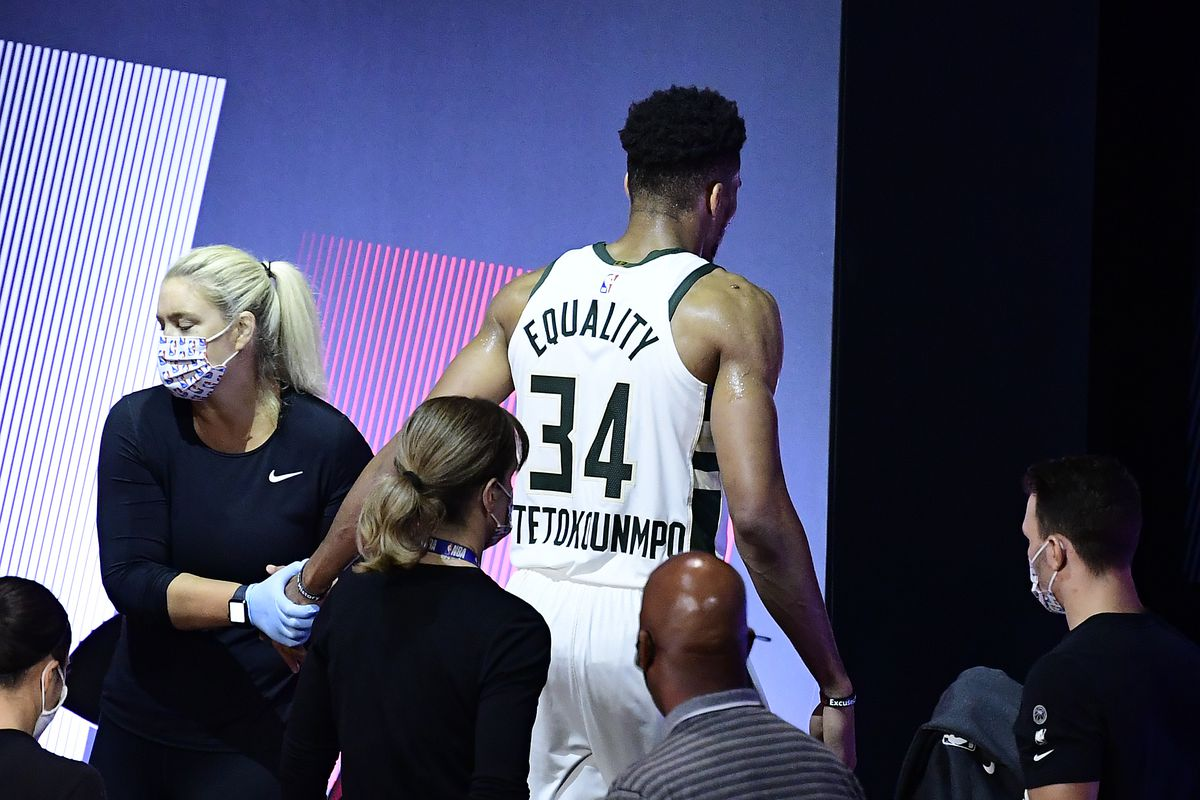 Giannis Antetokounmpo of the Milwaukee Bucks exits the game after an injury during the second quarter against the Miami Heat in Game Four of the Eastern Conference Second Round during the 2020 NBA Playoffs at AdventHealth Arena at the ESPN Wide World Of Sports Complex on September 06, 2020 in Lake Buena Vista, Florida.