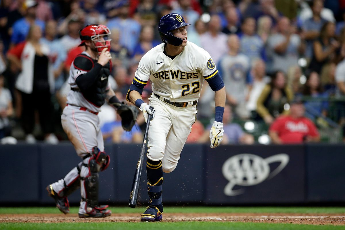 Christian Yelich #22 of the Milwaukee Brewers takes off for first base after the swing against the Cincinnati Reds at American Family Field on August 24, 2021 in Milwaukee, Wisconsin. Brewers defeated the Reds 7-4.