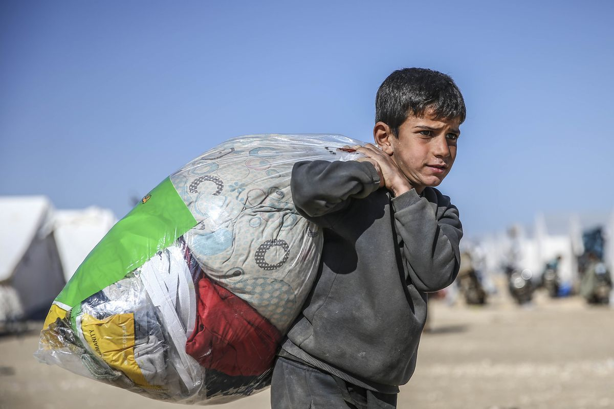 A boy forced out of Aleppo by the fighting.