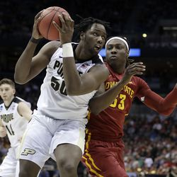 FILE - In this March 18, 2017, file photo, Purdue's Caleb Swanigan (50) drives against Iowa State's Solomon Young (33) during the first half of an NCAA college basketball tournament second-round game in Milwaukee. The Portland Trail Blazers selected Swanigan in the first round of the NBA draft Thursday, June 22. (AP Photo/Morry Gash, File)