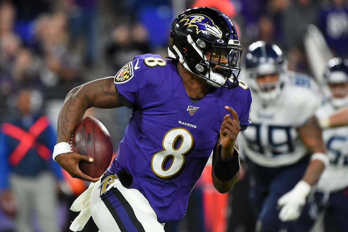 auarterback Lamar Jackson #8 of the Baltimore Ravens carries the ball against the defense of the Tennessee Titans during the 2020 AFC Divisional Playoff game