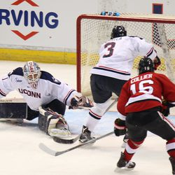 UConn's Ryan Segalla (3) tries to clear the puck after Tanner Creel's (1) save.
