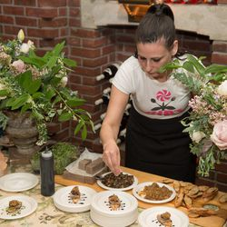 Amanda Cohen of Dirt Candy plating her Portobello Mousse with pear fennel compote.