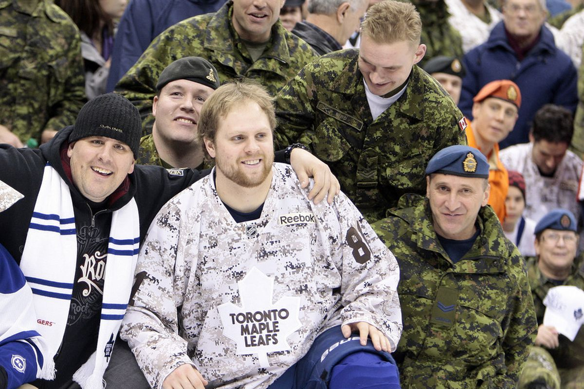 TORONTO - JANUARY 14: The Toronto Maple Leafs join the Canadian Forces on the ice after NHL action at the Air Canada Centre January 14, 2012 in Toronto, Ontario, Canada. (Photo by Abelimages/Getty Images)