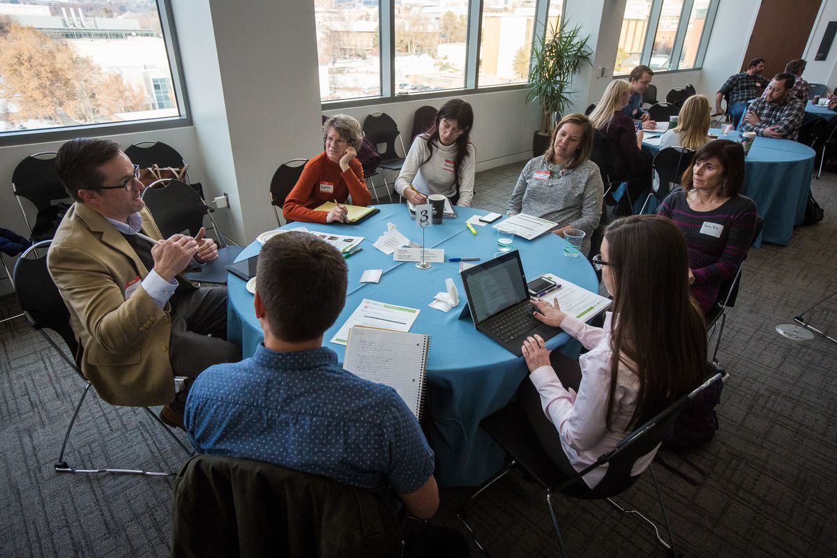 Attendees talk about air quality concerns during the group discussion session of the Dialogue on Collaboration event at the University of Utah's S.J. Quinney College of Law in Salt Lake City on Thursday, Dec. 6, 2018.