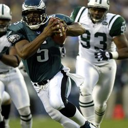 """<strong>2003 """"</strong>Donovan McNabb #5 of the Philadelphia Eagles avoids the rush of James Reed #93 of the New York Jets"""""""