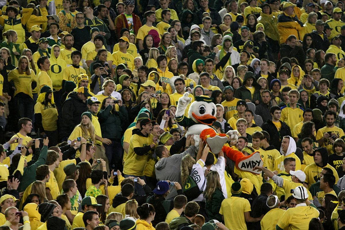 EUGENE OR - OCTOBER 21:  The Oregon Duck mascot is lifted into the crowd during the game against the UCLA Bruins  on October 21 2010 at the Autzen Stadium in Eugene Oregon.  (Photo by Jonathan Ferrey/Getty Images)