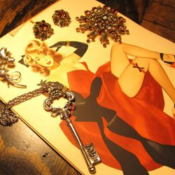 This arrangement of jewelry includes a multi-chain key necklace -$15, a pin and earring set (1960s) - $15, and an adorable mini rose pin - $6
