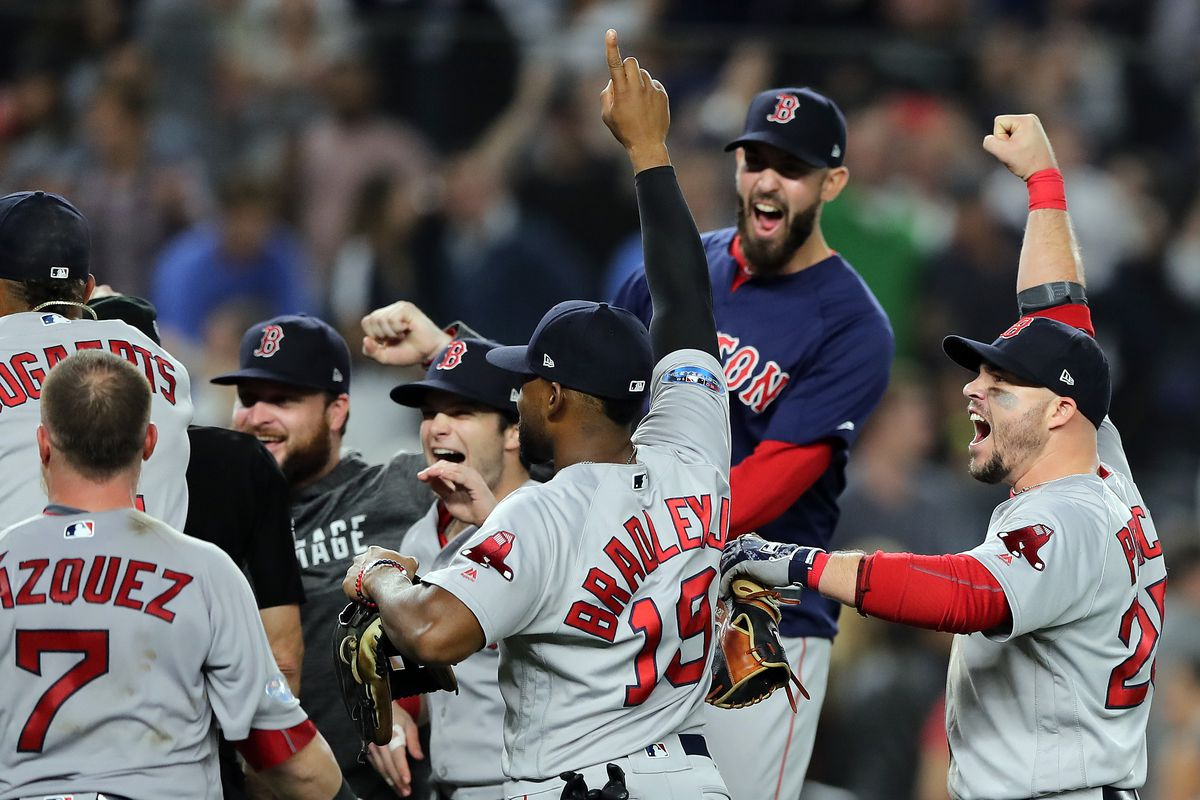 The Boston Red Sox celebrate on the field after winning the ALDS