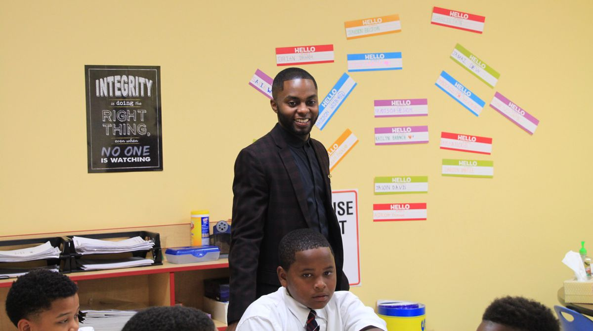 James Johnson visits a classroom at STAR Academy, where he became principal last fall.