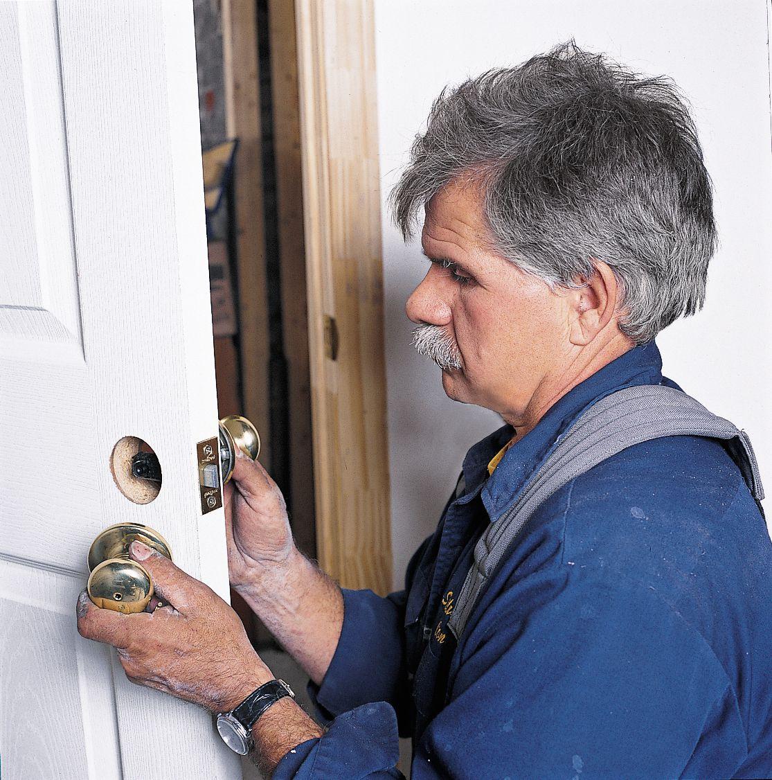 Man Installs Latch Hardware On Prehung Interior Door