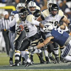 Idaho Vandals running back Ryan Bass (5) runs for a first down during first half action as BYU plays Idaho in the Cougar's final home football game on 2012 Saturday, Nov. 10, 2012,in Provo, Utah.
