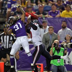Aug 9, 2013; Minneapolis, MN, USA; Houston Texans wide receiver DeAndre Hopkins (10) catches a touchdown pass over Minnesota Vikings cornerback Bobby Felder (31) during the second quarter at the Metrodome.