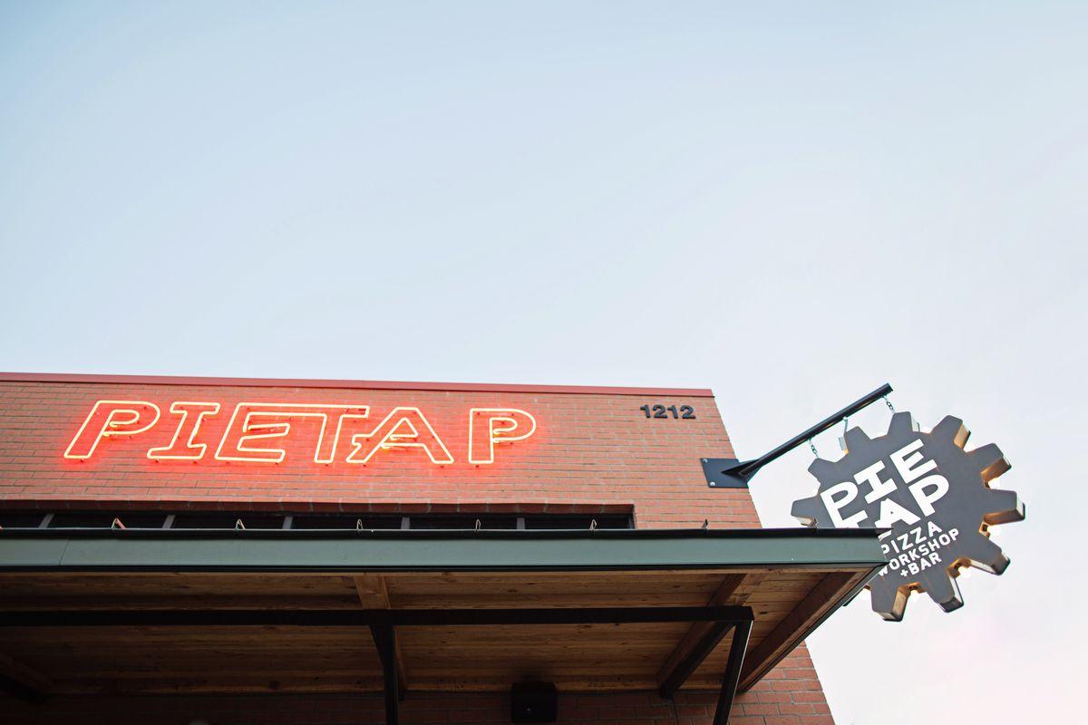 Exterior sign of Pie Tap Pizza Workshop
