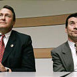 Republican Attorney General Mark Shurtleff, left, and Democratic challenger Greg Skordas attend a forum in Salt Lake.