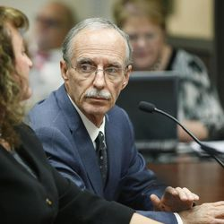 FILE - Salt Lake County Recorder Gary Ott meets with the Salt Lake County Council in Salt Lake City on Tuesday, Oct. 4, 2016. The council reviewed an audit of the county recorder's office. As county officials prepare to use their purse strings power to help address the troubling situation around Salt Lake County Recorder Gary Ott, state leaders also are pushing forward.