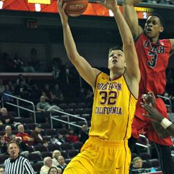 Princeton Onwas tries to block Nikola Jovanovic's layup.