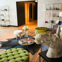 """With the opening of GlowOut, Dieas expanded her team and her services—and got to try her hand at interior design (another of her passions.)   Modeled on Dieas's idea of """"an old-world girl's club,"""" the cushy spot offers hairstyling services including blo"""