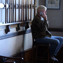 Libertarian vice presidential candidate Gov. Bill Weld catches up on phone calls while at the Alta Club as he and Gov. Gary Johnson pay a visit to Salt Lake City for a speech at the University of Utah on Saturday, Aug. 6, 2016.