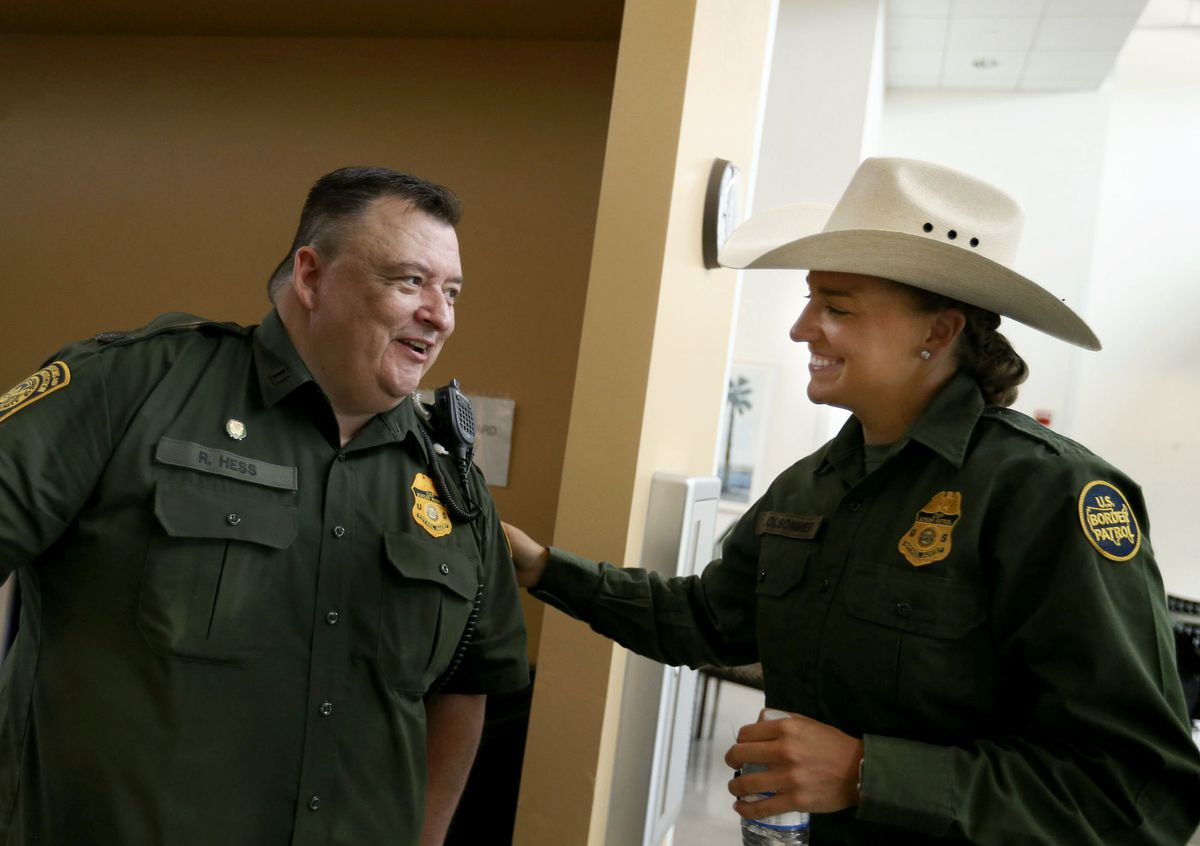 Supervisory Border Patrol agent and Rio Grande Valley sector chaplain Robert Hess, left, speaks with Border Patrol agent Justine Olsommer at the Border Patrol's Rio Grande Valley Sector Headquarters in Edinburg, Texas, on Tuesday, June 22, 2021.