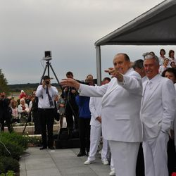 LDS Church President Thomas S. Monson pretends to lead the music as the choir sings at the close of the cornerstone ceremony. Also watching are President Dieter F. Uchtdorf, second counselor in the First Presidency, and Elder Russell M. Nelson of the Quorum of the Twelve during the cornerstone ceremony at the Kyiv Ukraine Temple dedication services Sunday, Aug. 28, 2010, in Kiev, Ukraine.