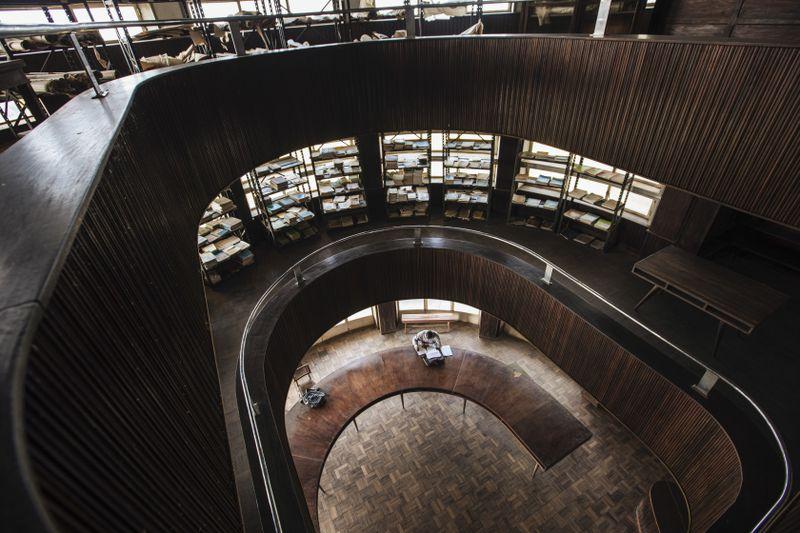 A man reads inside the Yangambi Library.