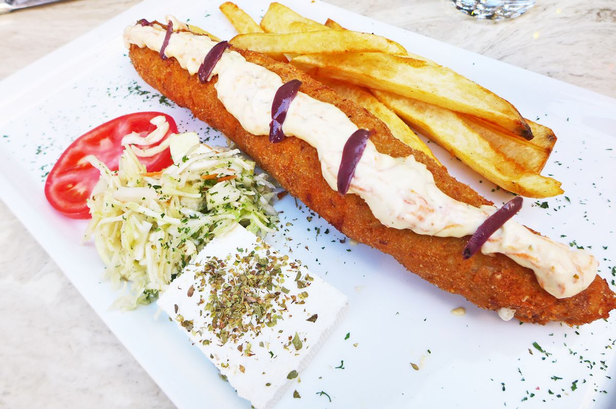 A long crumbed, rolled, and fried brown tube of meat.