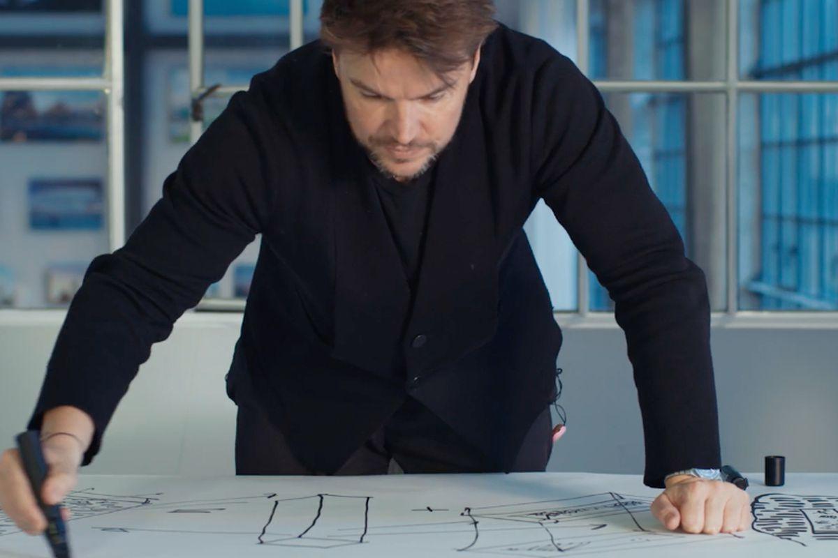 architect Bjarke Ingels hovering over a sketch