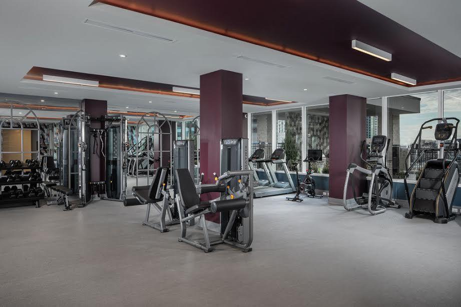 A gym with mauve walls.