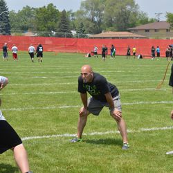 Chris Maragos (middle) and Joel Nellis (right) watch a blocking drill Saturday.