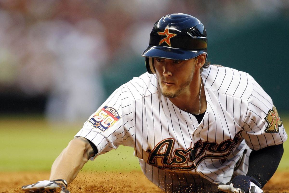 Apr 6, 2012; Houston, TX, USA; Houston Astros center fielder Jordan Schafer (1) dives back to first against the Colorado Rockies in the fifth inning at Minute Maid Park. Mandatory Credit: Brett Davis-US PRESSWIRE