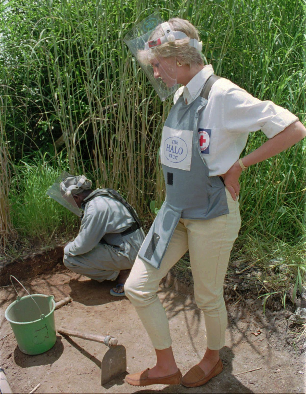 In this Jan. 15, 1997 file photo, Diana, Princess of Wales, wearing protective gear, watches a land-mine clearing demonstration in Huambo, central Angola, one of the most densely mined areas in the country.
