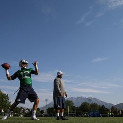 BYU quarterback Tanner Mangum delivers a pass on the opening day of fall camp at the school's outdoor practice field in Provo on Friday, Aug. 5, 2016.