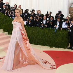 Blake Lively wears a Burberry gown.