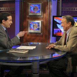 """FILE - This Nov. 3, 2005 file photo provided by Fox TV News shows """"Fox News Sunday"""" host Chris Wallace, left, pointing at his father, Mike Wallace, a CBS """"60 Minutes"""" correspondent, during taping of the television show in New York. Their talk represents the first time father and son had crossed paths professionally in careers that together stretches three-quarters of a century. Mike Wallace, the dogged, merciless reporter and interviewer who took on politicians, celebrities and other public figures in a 60-year career highlighted by the on-air confrontations that helped make """"60 Minutes"""" the most successful primetime television news program ever, has died. He was 93."""