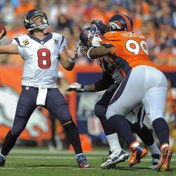 Houston Texans quarterback Matt Schaub (8) throws for a touchdown against the Denver Broncos in the second quarter of an NFL football game Sunday, Sept. 23, 2012, in Denver.