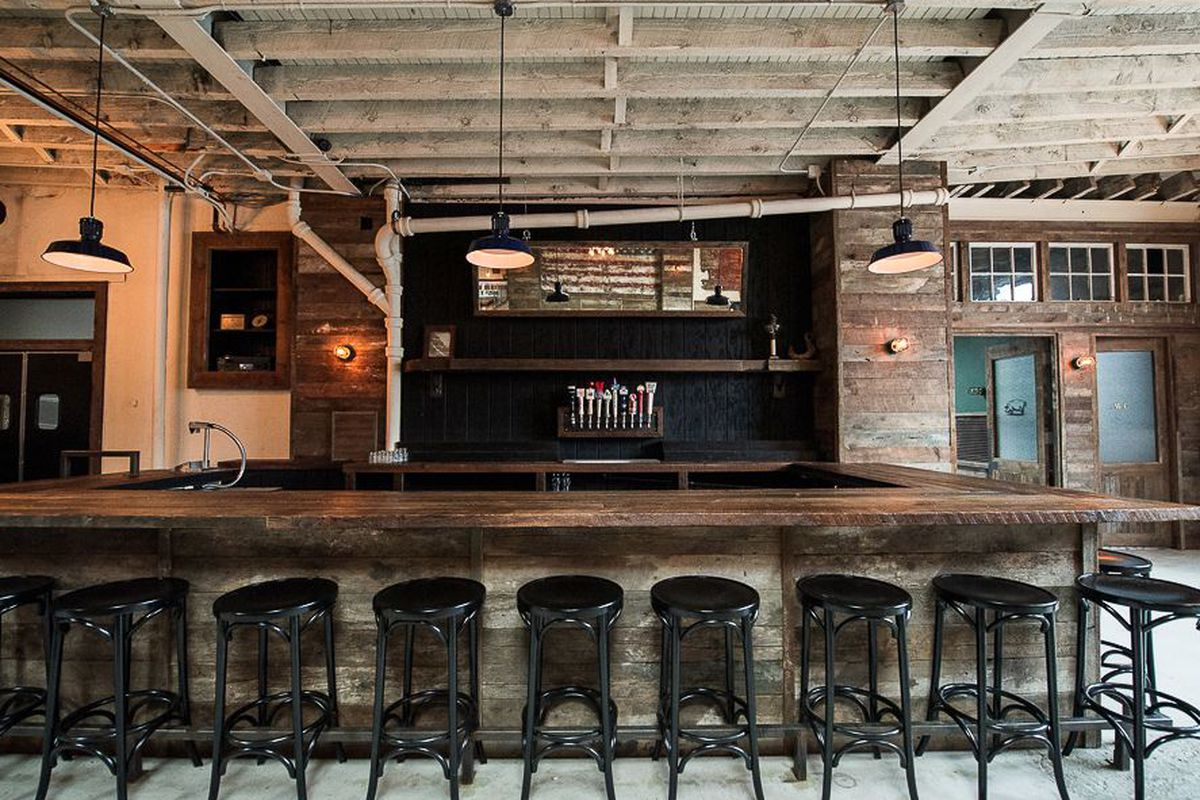 """<a href=""""http://ny.eater.com/archives/2013/08/hometown_a_massive_barbecue_restaurant_in_red_hook.php"""">Hometown, Brooklyn</a>."""