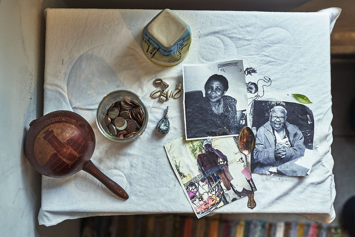 On a tabletop, mementos like photos and other keepsakes are displayed.