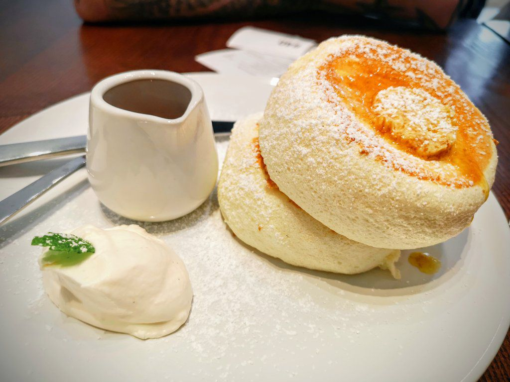 Souffle pancakes with a jug of syrup and butter at Fuwa Fuwa Cafe