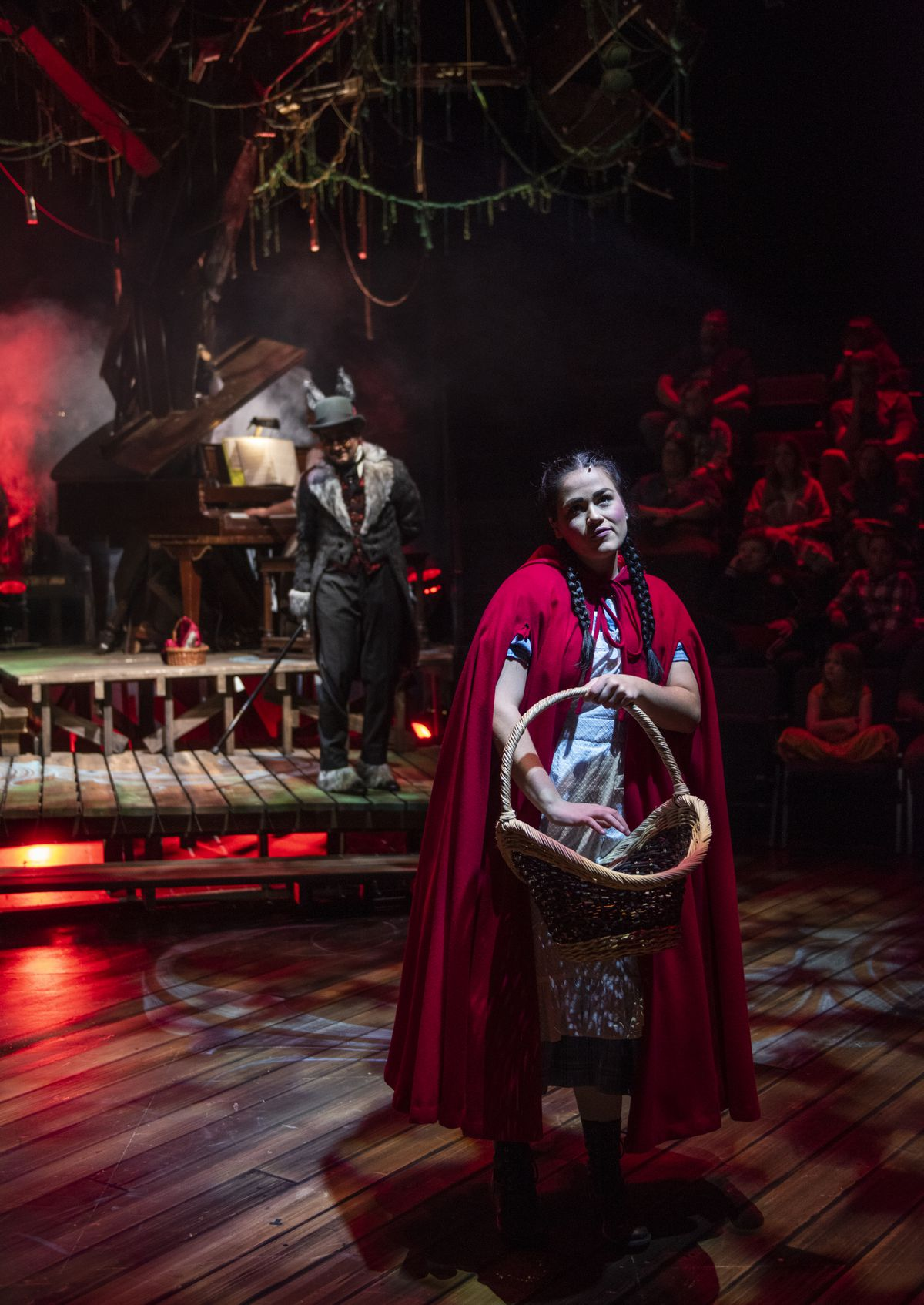 """Lucy Godínez stars as Little Red Riding Hood with Matt Edmonds (background, as the Wolf) in """"Into the Woods"""" at Writers Theatre."""