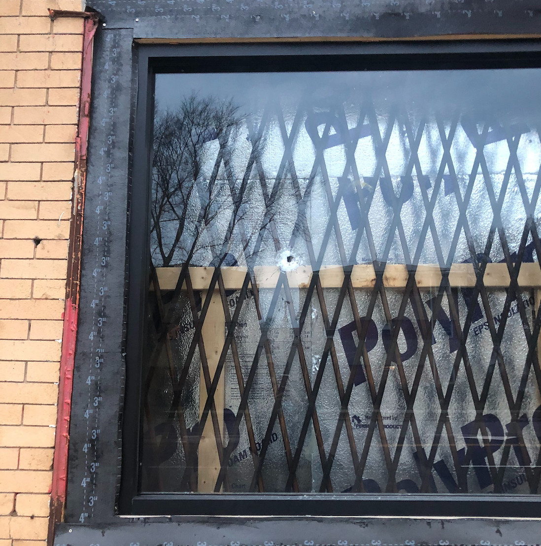 A bullet hole could be seen in the window of the Get Glammed Beauty Bar.